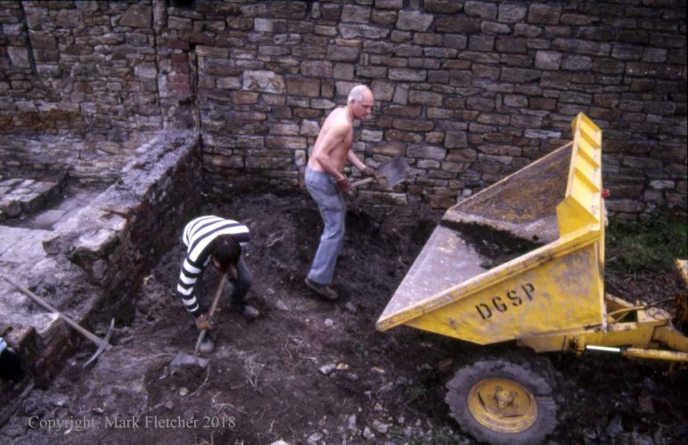 Hand-excavation of Smithy area, October 1987.